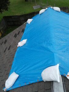 Temporary roof tarping